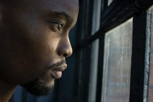 man contemplates how emotional immaturity contributes to substance abuse