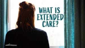 woman looking out window wondering what is extended care