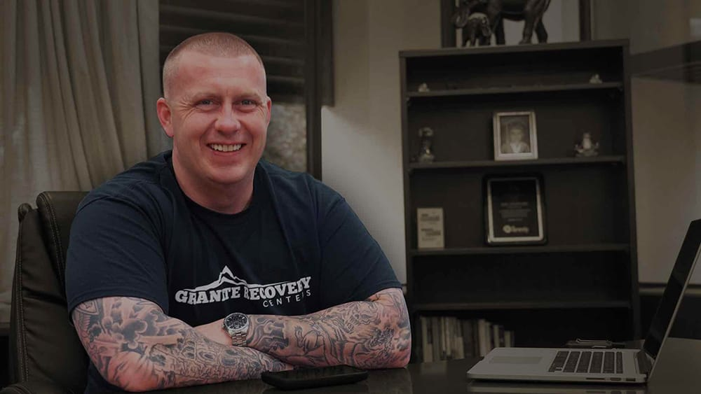 ceo at his desk at granite recovery centers