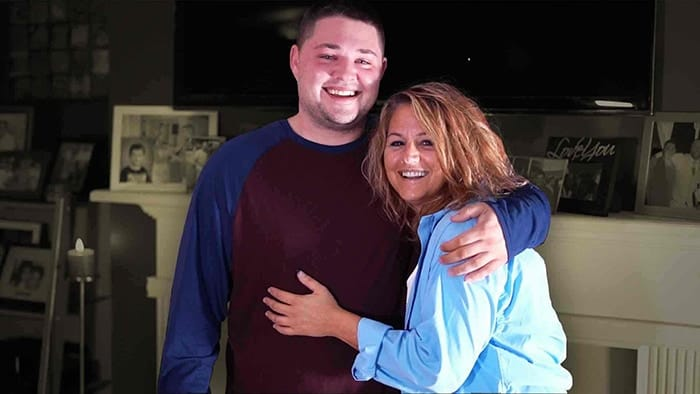 smiling son hugging smiling recovered mom from granite recovery centers