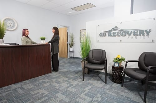front desk and entry sign and chairs at 4d recovery center outpatient rehab center