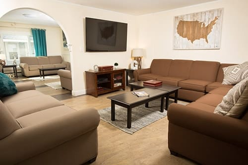 couches in living room at granite house for men