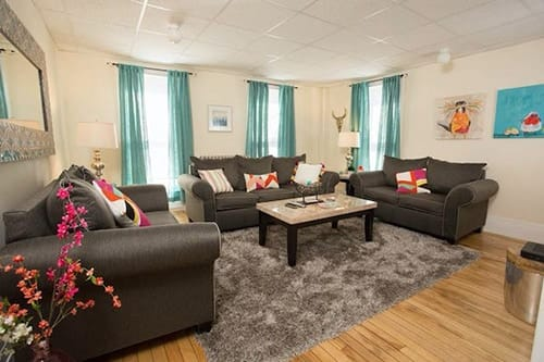 couches in living room at granite house for women