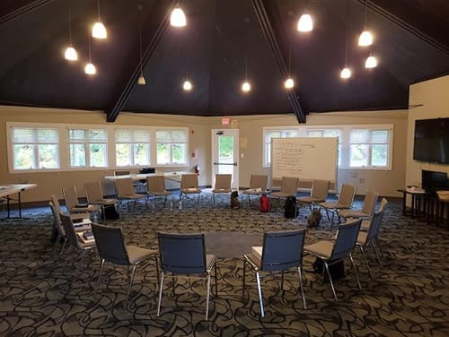 group room with chairs in circle with whiteboards at new freedom academy