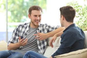 two male patients talk outside at a men's rehab center