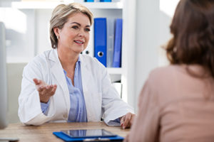 older female doctor talks to female patient about the benefits of gestalt therapy programs