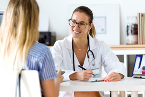 female doctor smiles while talking to a female patient in an opiate detox center