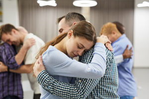 husband hugging wife during drug addiction treatment center program in Portland Maine