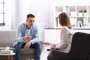 therapist and client discussing a drug detox center in Providence