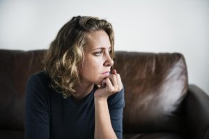 woman thinking about doing drugs while in new hampshire is in need of relapse prevention therapy