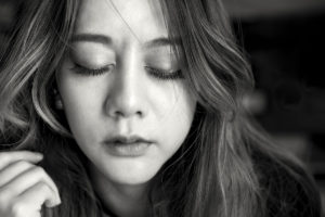 depression and anxiety, black and white close up of woman with eyes closed